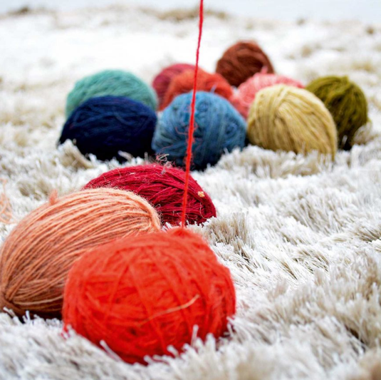 The dyed woollen yarn, rolled into balls, ready to be used on the loom.