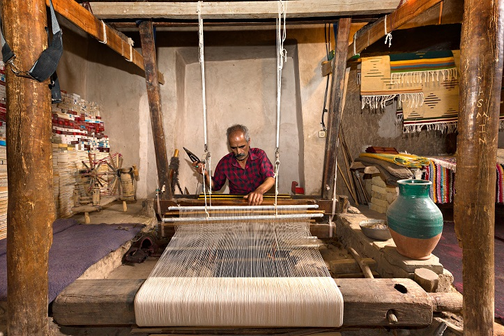 Iranian man weaves fabrics known as Aba, in traditional way, in the twon of Nain, Iran.