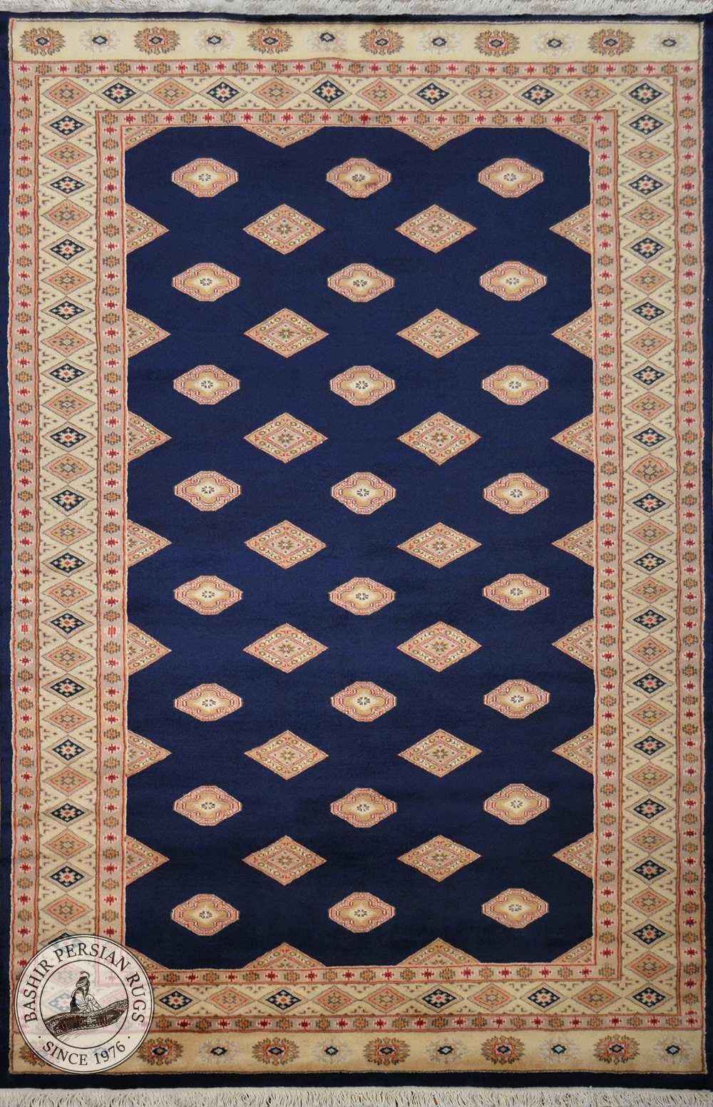 A hand-knotted Pakistani area rug called the Pende Bokhara and made of pure wool.