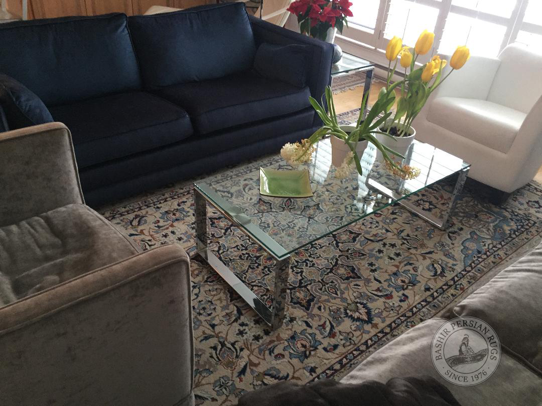 Evaluated Persian rug featured in a modern living room setting. Snapshot sent to us by one of our very happy customer.
