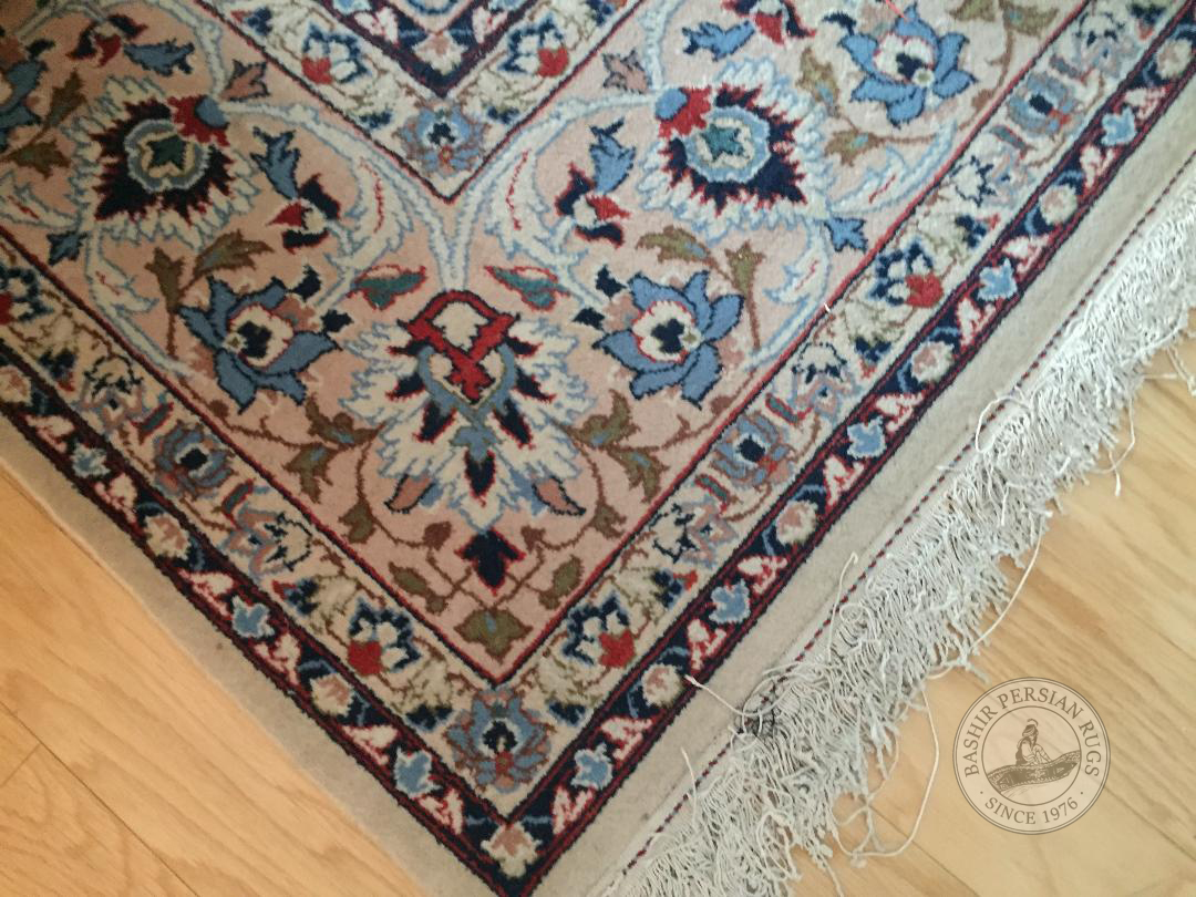 Area rug showing the corner of a repaired Persian rug. Snapshot sent to us by one of our very happy customer.