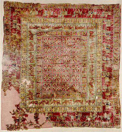 Pazyryk Rug: the oldest pile rug still in existence. Photo taken from the Hermitage Museum image collection.