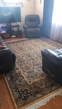 A rug purchased from our store displayed in a happy client's home
